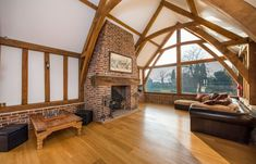 A stunning, light and airy #drawingroom with #Inglenook style fireplace, timber beams and delightful views overlooking the grounds and #pond in Creeting St Peter, #Suffolk