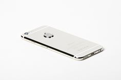 LUX IPHONE 6 IN WHITE FINISHED IN 950 PLATINUM WITH DIAMOND LOGO 128GB - Brikk   Lux iPhone 6 now available in yellow gold, pink gold and platinum with diamond options