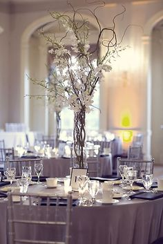 Tall centerpieces are great- we could do yours with orange and white flowers- add some crystals if you want some bling. Use candles around the base to give it a romantic #Flower Arrangement