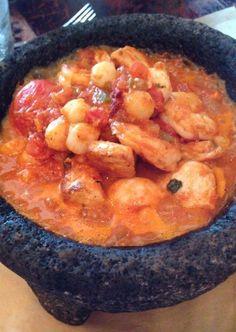 Molcajete Seafood: Shrimp, scallops, mahi-mahi, poblano chiles, calabaza squash, and charred tomatoes. HispanicKitchen.com