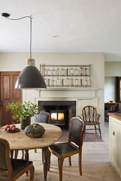Now restored, the fireplace casts a warm glow. Above it, the antique wood scarn, complete with 20 original spools of yarn, is a great conversation starter.