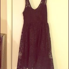 Free people lace black dress size 8 Beautiful lace with faint gold detail. Size 8, worn once. Free People Dresses Midi