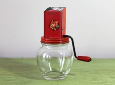 Red Lid and Handle with Floral Rose Appliqué and Clear Glass Base. Glass Jars, Clear Glass, Red Dinner Plates, Rose Applique, Spice Grinder, Anchor Hocking, Spices, Handle