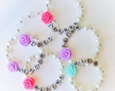 Personalized bracelet for your American Girl Doll. Listing is for the doll bracelet only. Comes in pearls with name and a star charm. Please
