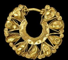 Minoan, circa 1600-1100 BC.   A gold openwork earring.
