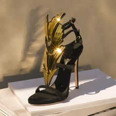 The Cruel stiletto heel is an absolute dream. Featuring a black suede triple strap sandal with 2 more adjustable straps with buckle. Embellished with golden metal wings. Stiletto Heels, High Heels, Giuseppe Zanotti Shoes, Shoe Company, Curvy Women Fashion, Luxury Shoes, Beautiful Shoes, Strap Sandals, World Of Fashion