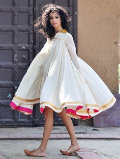 This breathtaking dual layered mulmul dress is crafted in cotton fabric. Multiple panels are finely finished with intricate gota work to give it a beautifu Kurta Designs, Blouse Designs, Pakistani Dresses, Indian Dresses, Indian Outfits, Cotton Dress Indian, Churidar, Cotton Dresses Online, Casual Dresses