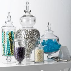 """Create a Candy Bar      Who doesn't love candy? Stark suggests creating an impromptu """"candy store"""" on an entry or side table with lidded apothecary jars in various sizes. Fill them with colorful taffy, chocolates and gummies, and put scoops and small baggies on the table. """"When guests drop by, they can take a sweet reminder of their visit on the road with them,"""" Stark says. Candy has a long shelf life (especially individually wrapped kinds), so you can enjoy the look all season long."""
