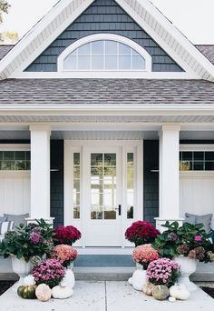 front porch with pillars and flowers