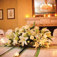 Brides.com: Centerpieces for Winter Weddings. Guests at Caitlin and Matthew's February wedding sat long tables adorned with centerpieces of hydrangeas, lilies, and roses atop a white tablecloth accented with ribbon. Bernadette Mitchell of Fiddler's Elbow Country Club
