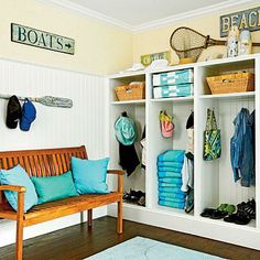 Liven up a mudroom with rustic signs, nets, and paddles. | Coastalliving.com