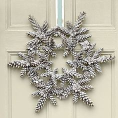 Oh My! This white Snowy Pinecone Wreath from Southern Living would look awesome on my red front door! wreath for January