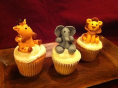 Giraffe, Elephant, and Lion 3D fondant cupcake toppers. The 1 year old recipient squealed in delight when she saw them!