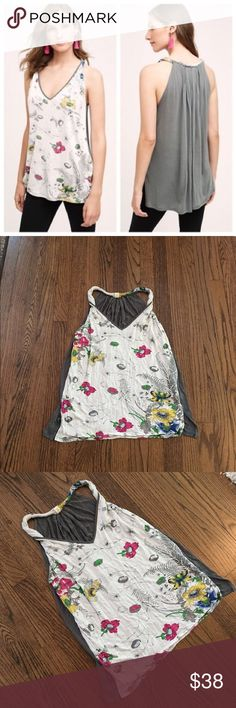 Tiny (Anthropologie) floral top Tiny brand floral tank top (sold at Anthropologie).  Excellent used condition.  Front is floral, back is solid gray.  2 inch slits on bottom sides of the top.  Pit to pit is 14.5 inches, length is 22 inches. Anthropologie Tops