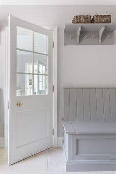 The boot room in the Park lodge project is located to the side of the house through the kitchen and utility. It has been designed with bench seating and artisan shelves with coat hooks above either side of the door to maximise storage. Kitchen Seating, Kitchen Benches, Kitchen Dining, Design Websites, Interior Design Living Room, Living Room Designs, Boot Room Utility, Family Room Design, Laundry Room Design