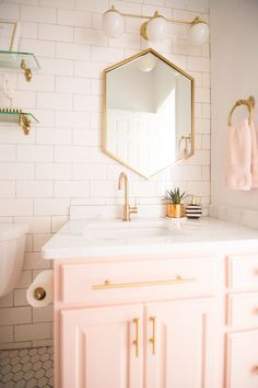 Home Decorating DIY Projects : Modern Glam Blush Girls Bathroom Design gold hexagon mirror blush cabinets gold hardware white hexagon floor glass shelves pink bathroom cabinets gold orb -Read More – Floating Shelves Entertainment Center, Black Floating Shelves, Floating Shelves Bedroom, Floating Shelves Kitchen, Bathroom Shelves, Glass Shelves, Bathroom Cabinets, Bathroom Organization, Bathroom Storage