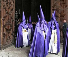 The distinctive cloaks and hoods (capirotes) of Spanish Holy Week processions.