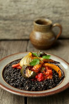 beluga lentils  Black lentils with tomato salsa and roasted vegetables.