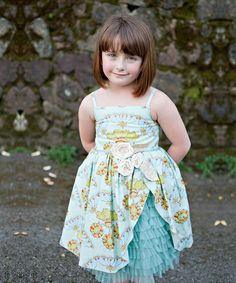 This beautiful frock boasts a mingling of prints that create a ladylike look sure to please any princess. Its cuddly cotton and tulle design has soft skin and sweet style in mind. Size note: This item runs large. Moxie & Mabel recommends ordering two sizes down.