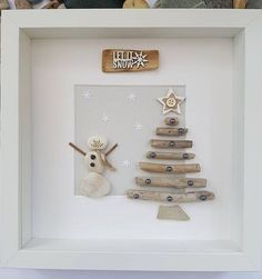 Pebble art picture of snowman next to driftwood christmas tree, unique gift, birthday, home decorThanks handofbod for this post.A beautiful and unique handmade beach pebble picture of snowman next to driftwood Christmas tree with driftwood si# Art # Christmas Pebble Art, Driftwood Christmas Tree, Christmas Rock, Christmas Makes, Stone Crafts, Rock Crafts, Holiday Crafts, Beach Rocks Crafts, Sea Glass Crafts