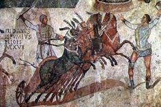 mosaicos cuádrigas en el que se ve a uno de los equipos de las carreras de caballos. Aparece un hombre dando la salida. Apartado 1.