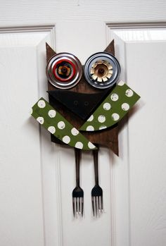 Owl hanging wall art. Folksy and whimsical, this cute owl is made from pallet wood and discarded materials including can and bottle lids as