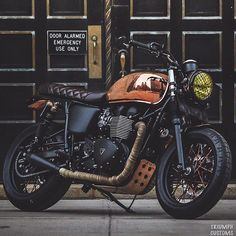 If you're going to customize a Triumph Bonneville Standard, you might as well go for broke. This Ducati Miss Moneypenny Triumph Bonneville Motorcycle is a. Triumph Cafe Racer, Triumph Scrambler, Triumph Motorcycles, Vintage Motorcycles, Custom Motorcycles, Custom Bikes, Cafe Racers, Street Scrambler, Bonneville Motorcycle