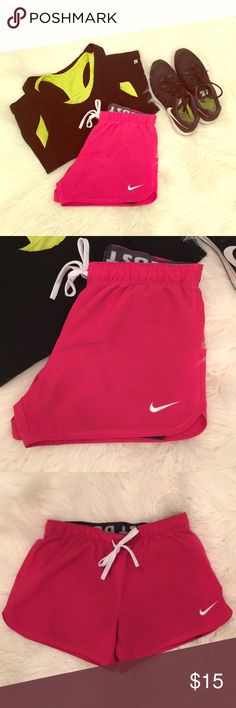 Nike Dry Fit Training Shorts Get ready for the new year with these cute pink Nike trainers! Spandex shorts inside to keep it all covered up. Gently used condition - worn <5 times. Nike Shorts
