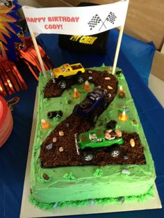 2 year old truck cake. Cute. Put white lines down middle of 2 to make road. Use dump truck or digger to make a mess