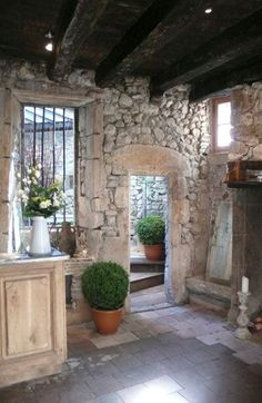 Rustic stone walls and wood ceiling in #Frenchfarmhouse.
