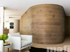 Curved wall designed by C+M Studio using mafi Curved Oak Country Brushed Grey Oil   Timber wall and floor boards.