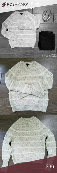 J. Crew Striped Wool Blend Sweater Cozy grey and white striped wool sweater. J. Crew makes the best sweaters! The pattern is chic and classic; the white stripes are a bit puffier, so they really stand out. So lovely.  Size Small; a bit snugger/shorter on me (I'm 5'7) than other J. Crew sweaters, so I'd say it's an XS - S. Some pilling throughout, as wool / mohair sweaters do. Nothing your sweater shaver can't fix!   Happy to answer any Qs. Happy Poshing! J. Crew Sweaters Crew & Scoop Necks