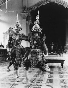 """""""The Ramayana"""" dueling with the kidnapping of Sita by Ravana. A duel is fought between Rama (left) and Ravana.  Classical Khmer Dancers of Cambodia, 1971."""