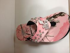 Realtree pink Camo flip flops. These are actually kind of cute.