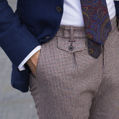 Tailored slim with a pleated front and side adjusters, from 100% pure wool by Ormezzano, these deep burgundy pied de poule patterned trousers are a real seasonal must-have.