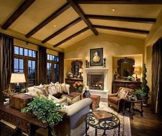 Love the buttery warm wall colour, the exposed beams, vaulted ceiling, the windows.  You just want to be sipping something like hot chocolate or a hot toddy and enjoying the room.