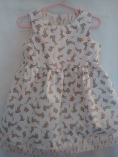 Cute as a Bunnie: Baby L / Toddler S Dress Lt Cream with tan bunnies eating carrots & Carrot hem. Soft cotton fabric w body. Lined bodice & Sleeveless