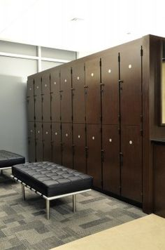 "These fitness center lockers are double stack and built using Nevamar ""Kona Blend"" plastic laminate with black melamine interiors."