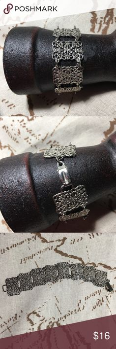 "Vintage silver tone charm bracelet Bracelet measures 7"" long. Each chain linked charm measures .5"" wide and 1"" long.  In good condition. Vintage Jewelry Bracelets"