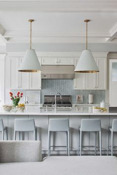 love the color scheme- white cabinets and countertops with hint of blue backsplash.