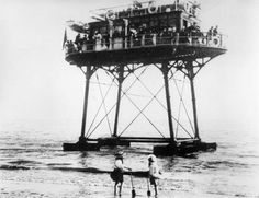 "The Brighton ""Daddy Long-Legs"", a 19th century tram. The tracks run underwater."