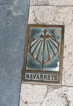 A marker in the pavement indicates the route of the Way of St. James through Navarrete, La Rioja,