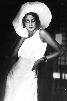 Jacque-Henri Lartigue.  This woman must've loved reading fashion mags of her time - she strikes a magnificent, spirited pose.