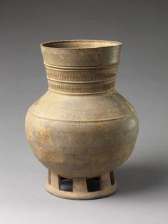 Footed Jar Period: Three Kingdoms period, Silla Kingdom (57 B.C.–A.D. 668) Date: mid-5th century Culture: Korea Medium: Stoneware with traces of ash glaze Dimensions: H. 13 in (33cm)