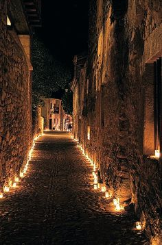 "Pedraza is one of those medieval small villages you can get from Madrid for a daytrip. Its ""The Night of Candles"" takes place one night per year in July, when there is not unlit a single corner of the town. http://www.touristeye.com/Attend-a-candlelight-concert-in-Pedraza-Pedraza-p-651473"
