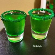Green With Envy Shot - For more delicious recipes and drinks, visit us here: www.tipsybartender.com