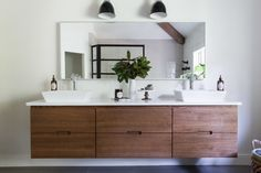 """Before Dana and her husband got to it, the bathroom was COMPLETELY mirrored! Yikes! The <a href=""""http://www.ikea.com/us/en/catalog/products/50038213/"""" target=""""_blank"""">rectangular mirror</a> over the hovering vanity is the only remnant of that."""