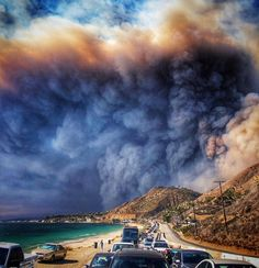 The smoke from the fire is seen from the Pacific Coast Highway as residents flee Malibu and nearby areas La County Sheriff, Dream Cars, California Wildfires, Wild Fire, At Least, Surfing, Clouds, Beach, Places