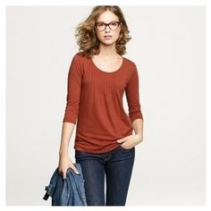 """Dear Stitch Fix Stylist, I have an old red shirt that has similar pintucks just on the chest area that is fitted in the neck and chest, but blouses out over my stomach. Could you find similar shirts/styles that would make me feel less self-conscious about my """"I had a baby 3 months ago mommy-pooch?"""""""