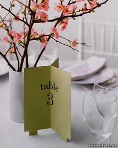 Trifold Table Numbers  Like a beacon, this table number declares its location in all directions.